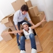 Happy couple moving — Stock Photo #7772558
