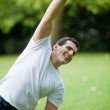 Man stretching outdoors — Stock Photo #7772560