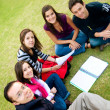 Stock Photo: Group of students studying outdoors