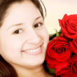 Beautiful girl with red roses - Stock Photo