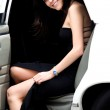 Girl coming out a limousine — Stock Photo #7772655