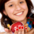 Stock Photo: Beautiful girl holding apple