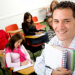 Casual student or teacher in a classroom — Stock Photo