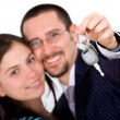 Happy couple with new car keys - Foto Stock