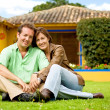 Happy couple outside their home — Stock Photo #7772823