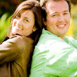 Stock Photo: Happy couple portrait - back to back