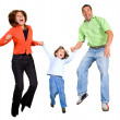 Happy family jumping — Stockfoto