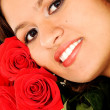 Beautiful female portrait with roses — Stock Photo