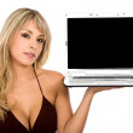 Beautiful girl showing a laptop — Stock Photo