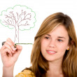 Girl drawing a tree on screen — Stock Photo