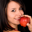 Stock Photo: Girl eating an apple