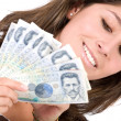 Beautiful girl with lots of money — Stock Photo
