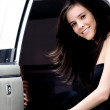 Young girl in a limousine — Stock Photo #7772993