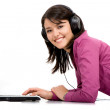 Listening music on a laptop computer - Stockfoto