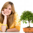 Pretty girl portrait with a tree — Stock Photo