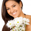 Happy girl with flowers — Stockfoto