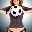 Beautiful girl holding a football — Stock Photo #7773113