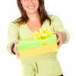 Beautiful woman carrying a gift — Stock Photo