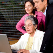 Family on a laptop — Stock Photo #7773168