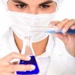 Female chemist using test tubes — Stock Photo #7773175