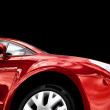 Royalty-Free Stock Photo: Red car on black