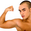 Fit man showing off his muscles — Stock Photo