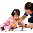 Father teaching his daughter - Stock Photo