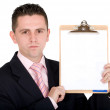 Business man holding pad — Stockfoto