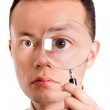 Man with magnifying glass - Stock Photo