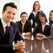 Business team in an office — Stock Photo #7773327