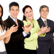 Business team smiling and applauding — Stock Photo