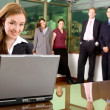 Business woman and her team — Stock Photo #7773403