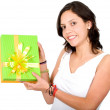 Casual girl with a gift - Stock Photo
