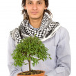 Stock Photo: Male ecologist holding a tree