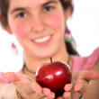 Girl offering an apple — Stock Photo