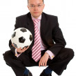 Business man and a football — Stock Photo #7773541