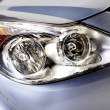 Car head lights in silver — Stock Photo
