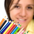 Girl holding colour pencils — Stock Photo