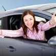 Woman happy with her new car - Stok fotoğraf