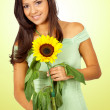Casual girl with sunflower — Stock Photo #7773596
