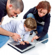 Family on a laptop computer — Stock Photo #7773660