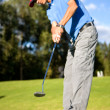 Male golfer in putting green - Stock Photo