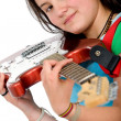 Girl holding an electric red guitar - Stock Photo