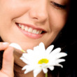 Happy girl with a white flower — Stock Photo
