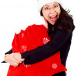 Stock Photo: Happy female santa with gifts