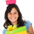 Casual girl full of gifts - Stock Photo