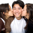 Twins kissing a man — Stock Photo
