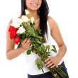 Beautiful girl holding flowers — Stock Photo #7774107