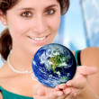 Business woman holding a globe — ストック写真