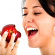 Girl eating an apple - Stock Photo
